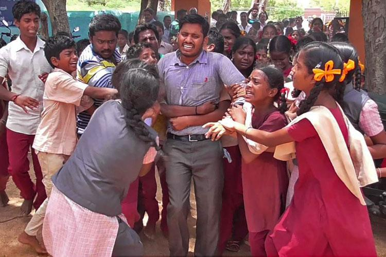 Dont go sir TN students cling on to their teacher refuse to accept his transfer