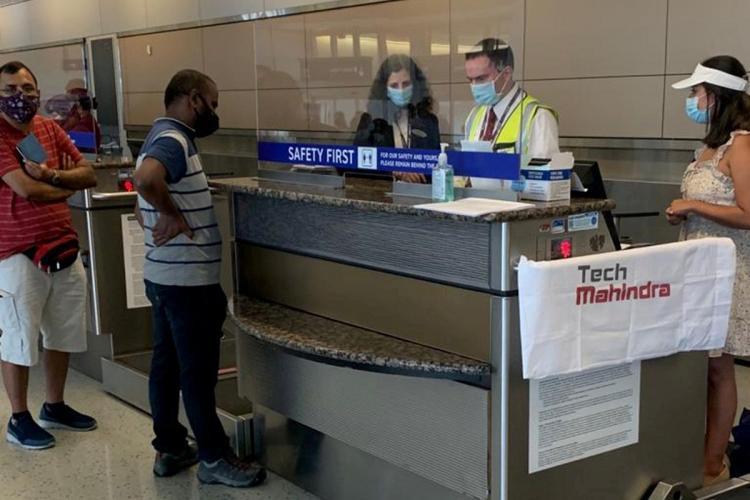 Employees of Tech Mahindra at a US airport waiting to head to India amid the coronavirus pandemic
