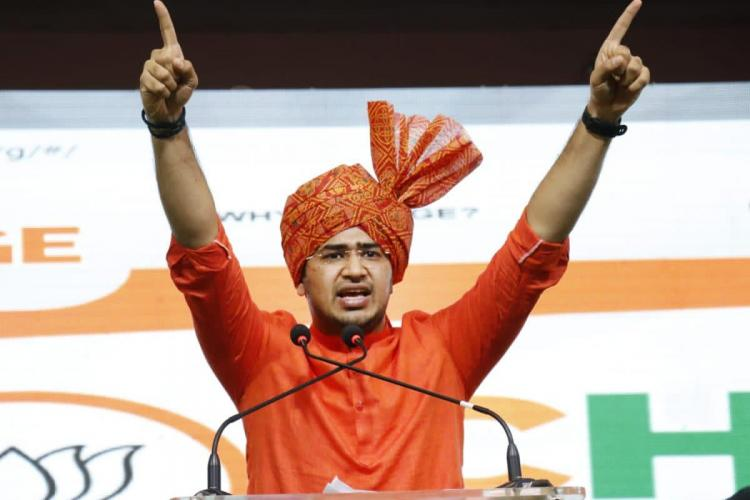Tejasvi Surya wearing a saffron turban with hands outstretched