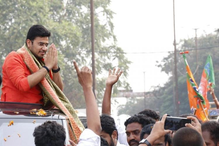 Tejasvi Surya can be seen in an orange kurtha addressing a gathering from his Jeep