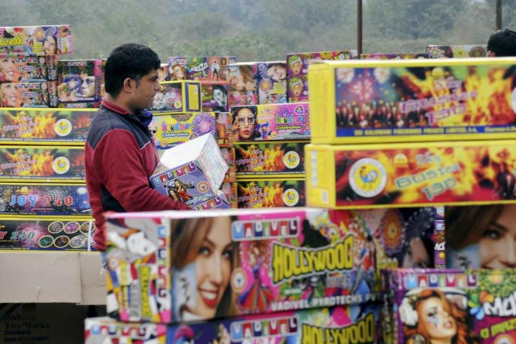 A shopkeeper selling firecrackers