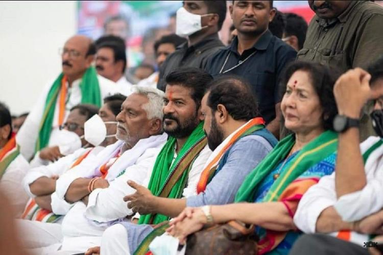 Telangana congress leaders sitting on a stage along with the party workers
