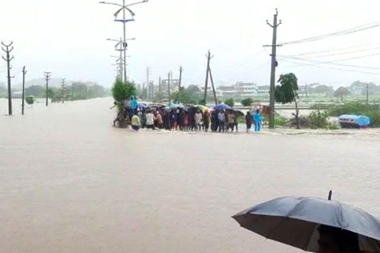 People stranded after an a reas became inundated due to heavy rains