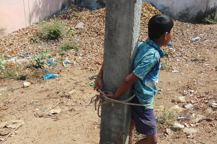 Telangana father ties minor son to pole for skipping school activists demand action