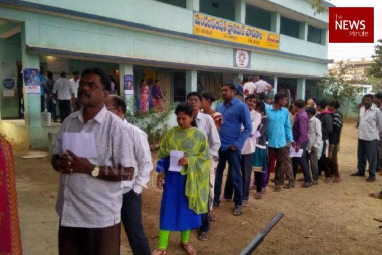 An image showing voters who lined up for voting in town in Telangana