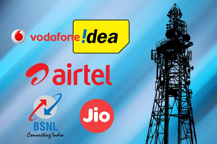 The logos of Vodafone Idea Airtel BSNL and Jio next to a telecom tower in the backdrop of the sky