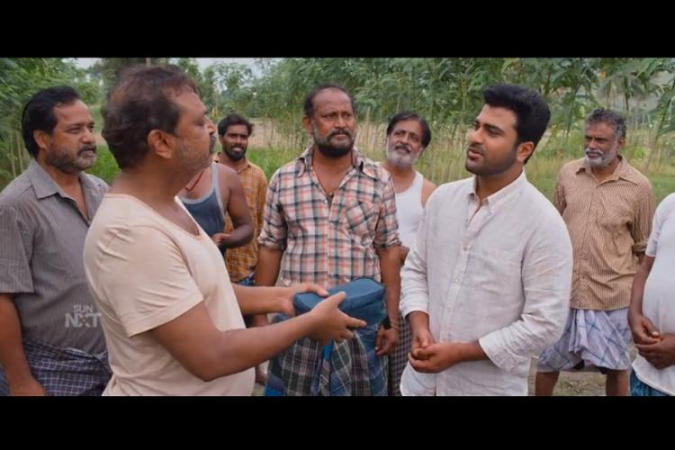 Sharwanand along with other cast and crew in a scene from agricultural field