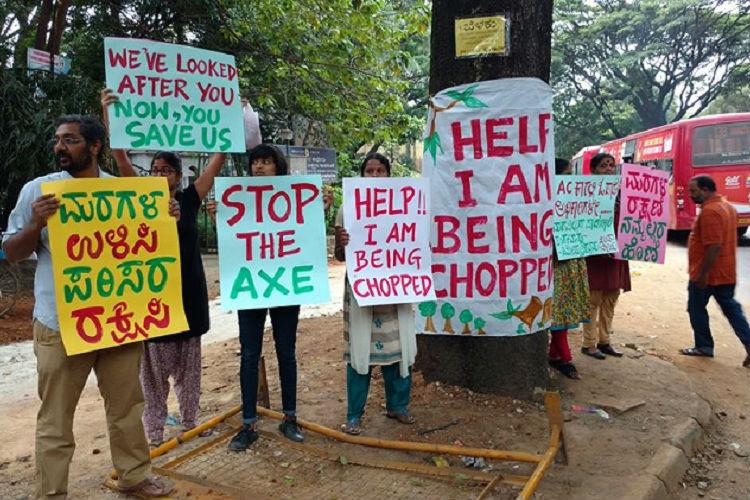 Dont cut down trees to make way for bigger footpaths Protest against TenderSURE in Bengaluru
