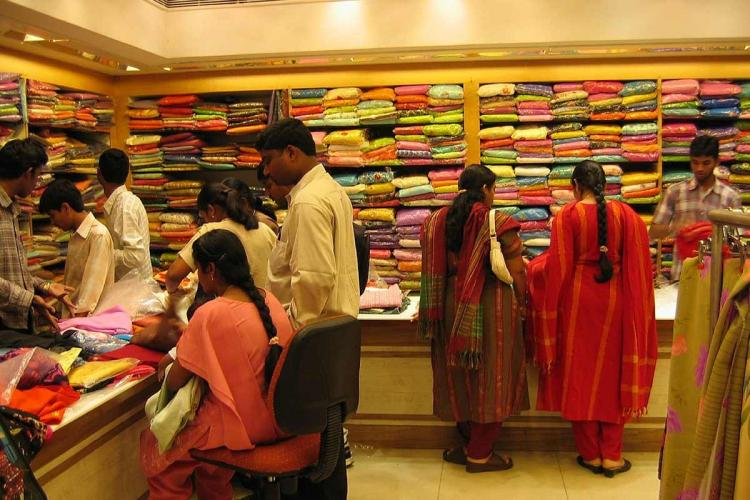 People inside a textile shop checking out clothes