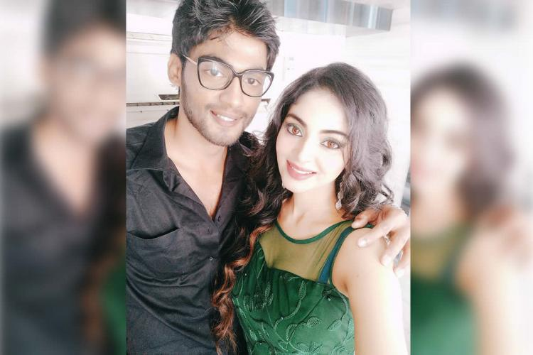 Tharshan in a black shirt posing with Sanam Shetty who is wearing a green outfit