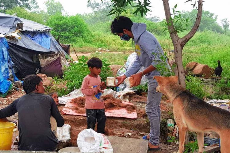 A team member distributing bread to flood-impacted families