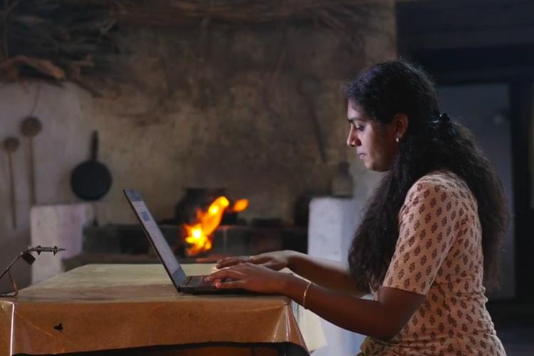 Nimisha Sajayan with laptop in The Great Indian Kitchen