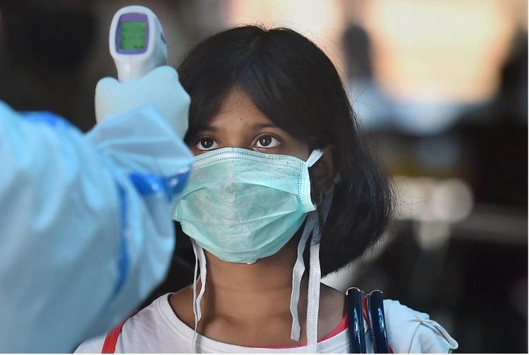 Thermal screening on a girl at Kolkata
