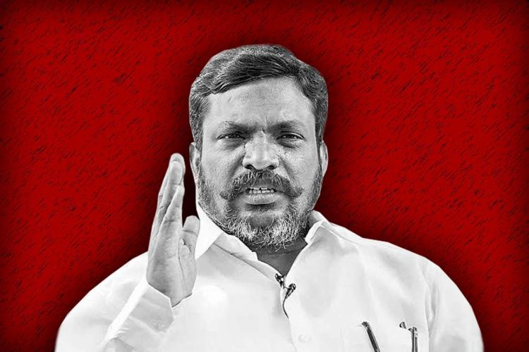 VCK chief Thol Thirumavalavan with his hand pointing out