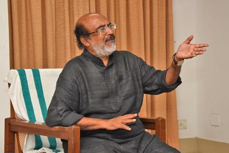Kerala Finance Minister Dr Thomas Isaac at his office. He is speaking to somone