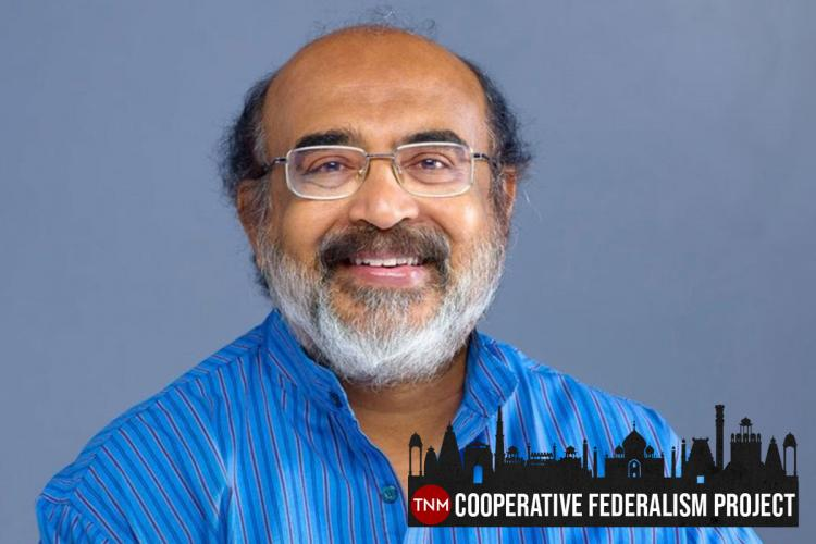 Kerala Finance Minister Thomas Isaac wearing a blue kurta smiling