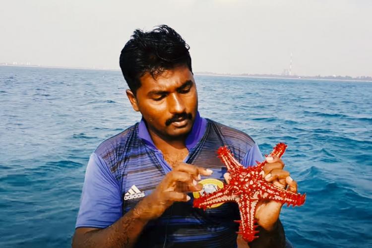 YouTube vlogger Sakthi vel holding star fish
