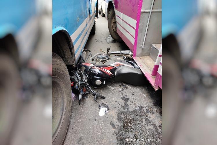 Kerala Men Evade Death By A Whisker As Bike Falls Between Two