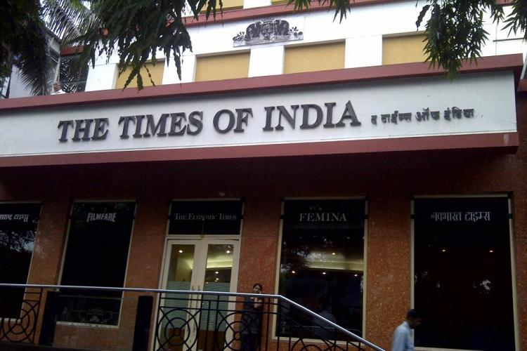 Times of India office on FC Road with two people outside