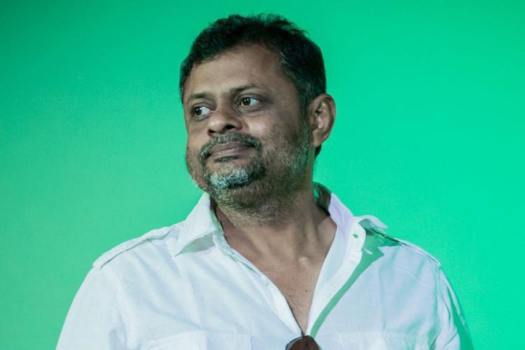 Tirru cinematographer in front of green background