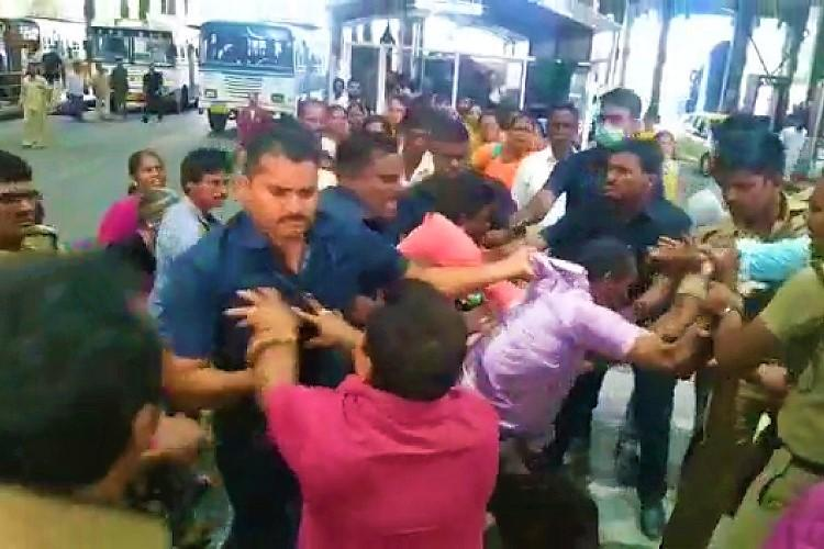 Caught on cam Security men in Tirupati thrash devotee for allegedly carrying gutka