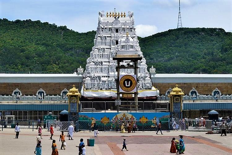 Two NRIs donate Rs 135 cr to Tirupati temple hand cheques to TTD officials
