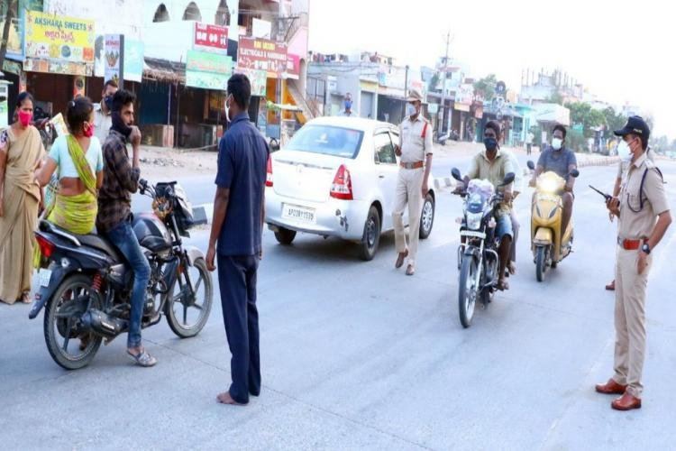 Police officials during the curfew checks in in Tirupati