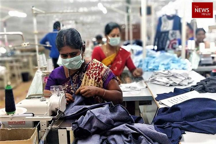 Garment workers seen operating a sewing machine