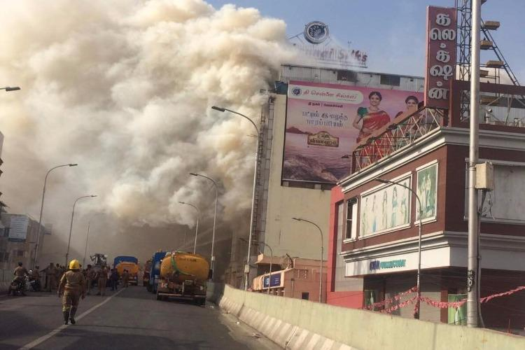 After many continuous hours of fire Chennai Silks building dangerously weakened