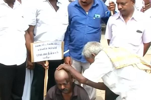 DMK worker in Tirunelveli shaves head to protest Mohideen Khans candidature in Pallyamkottai
