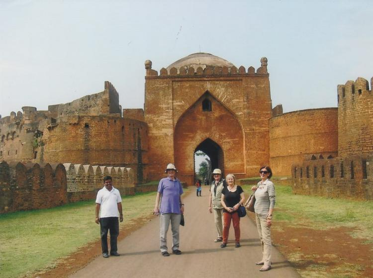Tourist guide Madhusudhan wearing white t shirt at Bidri fort along with foreign tourists as a part of Deccan tour