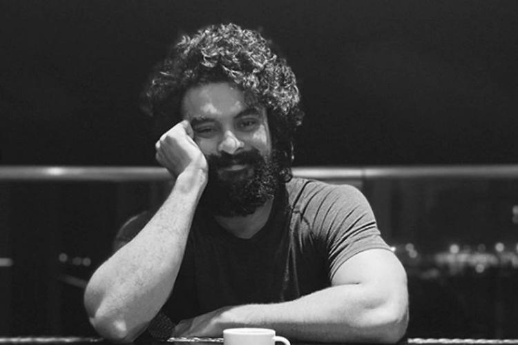 Actor Tovino Thomas. He is smiling looking straight
