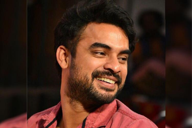 Actor Tovino Thomas He is looking towards right and is smiling