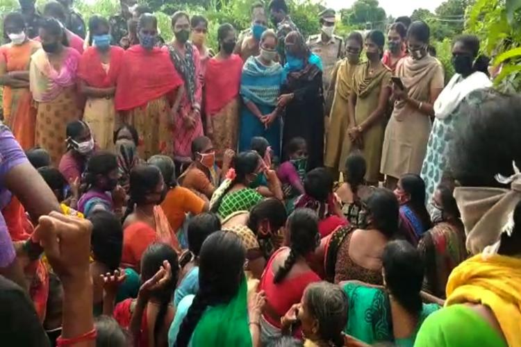 Group of women from village protesting in the village