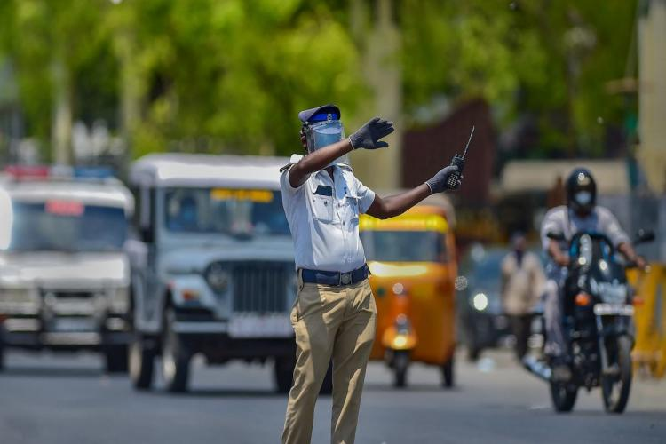 A police personnel attempts to control traffic near Chennai Central Railway Station after authorities eased restrictions during the ongoing COVID-19 nationwide lockdown in Chennai Tuesday May 5 2020