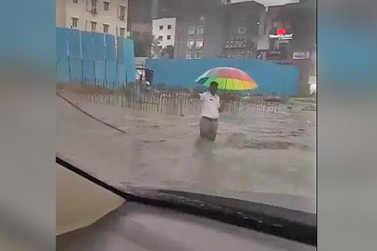 Video Hyd cop stands in knee-deep water and directs traffic wins hearts on the internet