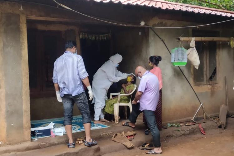 Test for novel coronavirus being conducted by a team of medical professionals in Attapadi