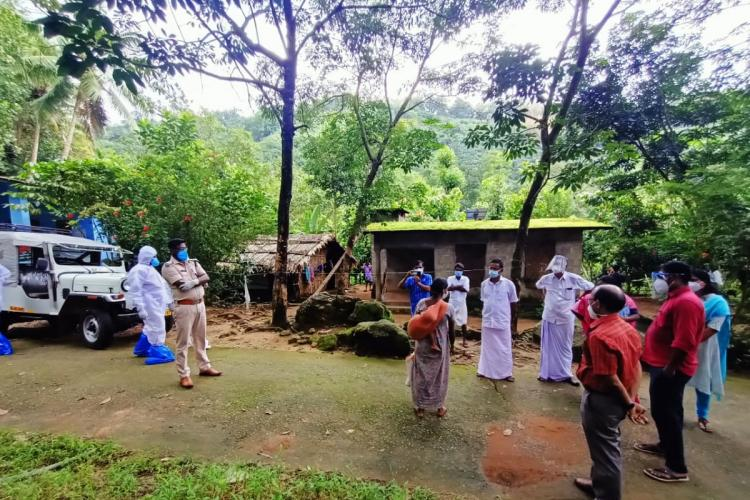 Officials and police involved in shifting tribals infected by COVID-19 at Kunchipara tribal hamlet to the domiciliary facility
