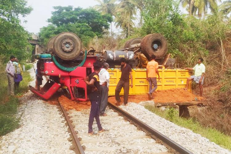 Toppled truck near Hassan