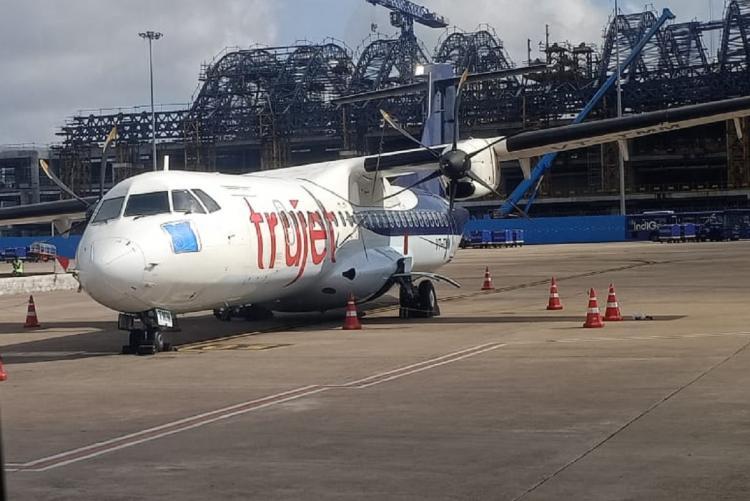 A Truejet flight parked in an airport