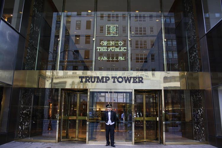 A doorman stands outside the Trump Tower in New York
