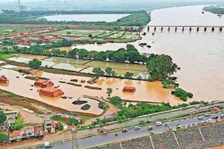 Tungabhadra dam showing flooded water in all over the places