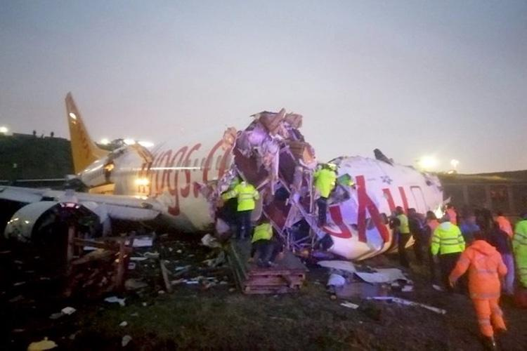 Three dead 179 injured as plane skids off Istanbul airport runway splits into three