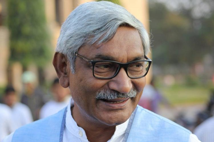 A file photo of U Sambasiva Rao He is seen wearing glasses and a half-sleeved blue jacket over a white t-shirt and spectacles He is looking away from the camera and smiling faintly