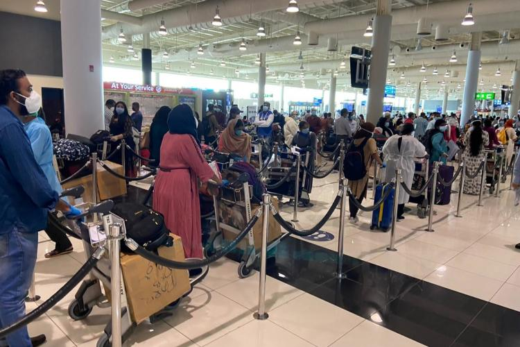 A line of passengers at the Dubai airport