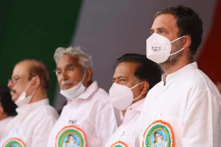 Four politicians in white stand in attention facing sideways