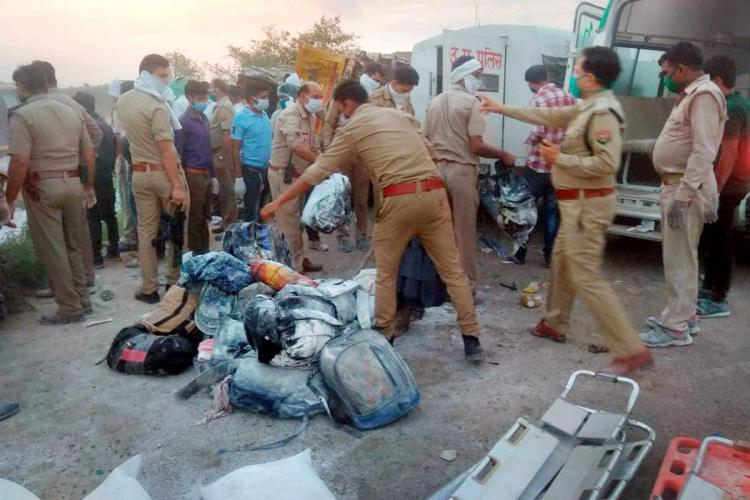 Police at the accident in Uttar Pradesh which killed 24 migrant workers