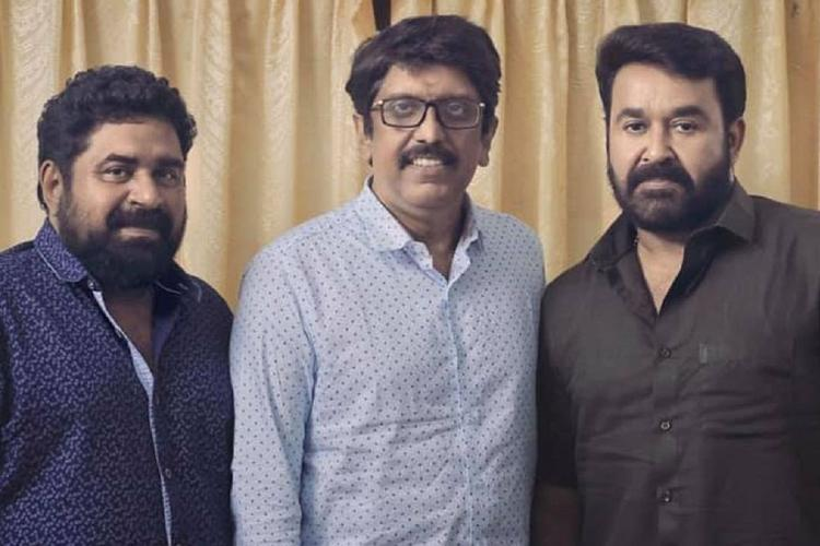 Udayakrishna B Unnikrishnan and Mohanlal stand together against a cream curtain