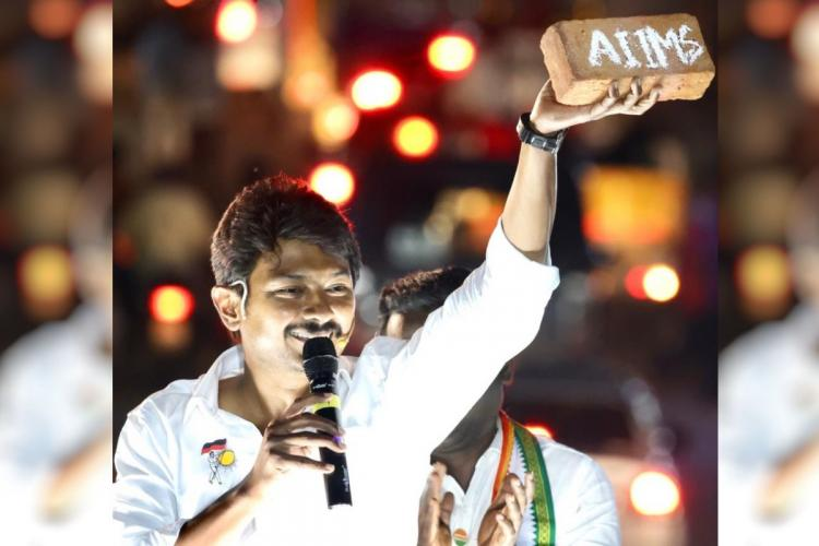 Udhayanidhi holds brick in hand
