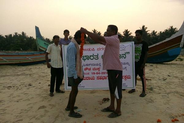Udupi officials want to stop open defecation with garlands instead of fines